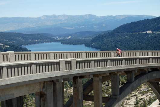 photo of cyclist crossing bridge near Donner Pass, CA