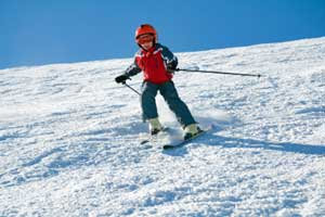 photo of young skier on slope